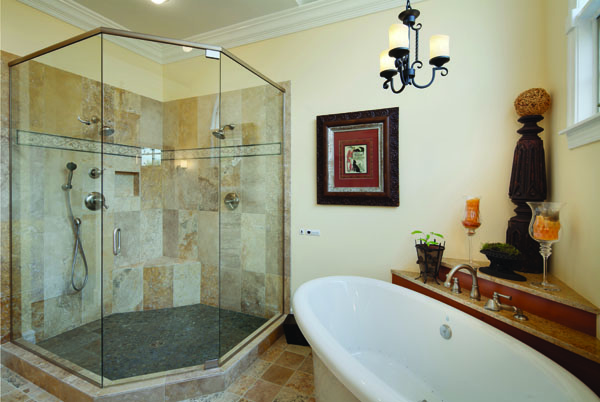 In This Spanish Mission Styled Master Bathroom, The Multi Colored Limestone  Floor Tile And Warm Tones Of The Knotty Alder Vanity Bring The Character Of  The ...